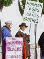 Mormon protesters - 'Mormon Jesus is Devil's Brother' and 'Mormon say Blacks are Cursed'